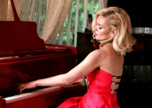 Oksana playing red piano