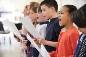 Children singing in choir together