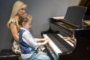 Oksana with Son playing Piano at Recital 2017